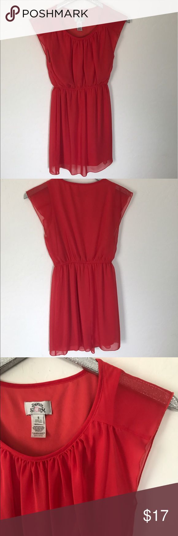 Short Sleeve Salmon Dress This dress features as elastic waist and has a nice flowy fit! Perfect for a brunch date or church! Sweet Storm Dresses