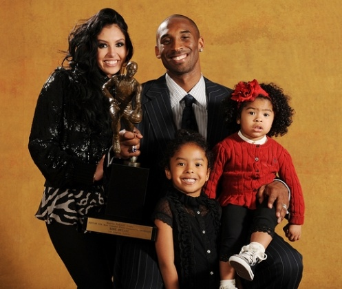 Kobe Bryant & family  Yeah there cute!!! ;)