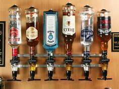 Rack and Pour bottle rack systems hold liquor bottles upside down and dispense precise shot sizes through measuring heads which are inserted into bottles.