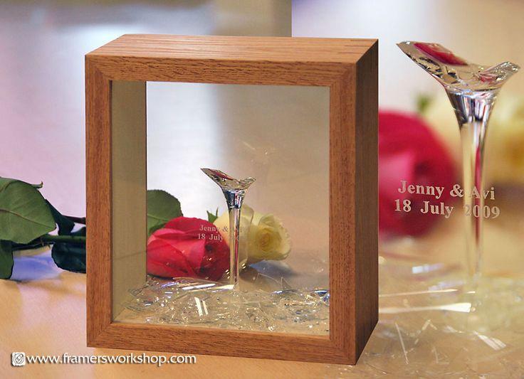 A framed broken Jewish wedding glass.