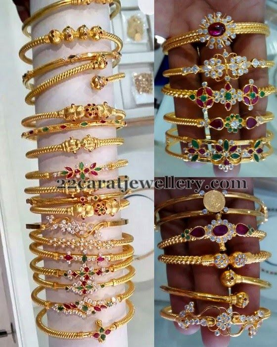 22 carat gold kada designs with screw open and CZ stones, rubies, emeralds all over. Classic floral design embellished across the bangle....
