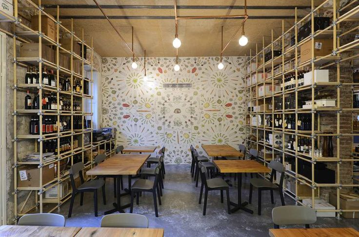 Una parete è rivestita con la carta da parati disegnata ad hoc dal food illustrator Gianluca Biscalchin Interior design RGA studio