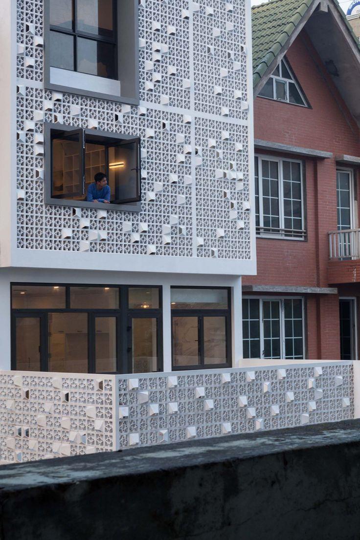 Unique Concrete Blocks in Cocoon Home's Facade in Vietnam