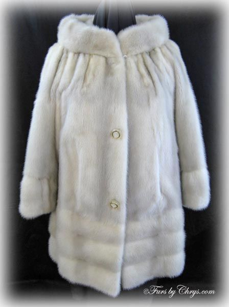 Azurene Mink Jacket AM752; $750; Very Good Condition; Size range: 4 - 8 Petite. This is a beautiful genuine natural azurene mink fur jacket. It has a Maple Furriers label and features a large stand-up collar, which almost reaches to the shoulders, and horizontal pelts on the cuffs and hem of the coat. This azurene mink jacket has that iconic Jackie O style that will always be relevant! When your outfit calls for a fur jacket that is out of the ordinary, you will wear this beauty!