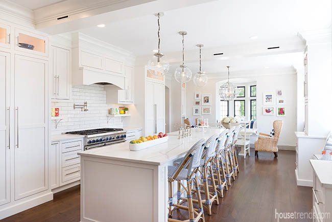 the newly remodeled kitchen is very kid friendly with bar chairs made of durable rattan - Newly Remodeled Kitchens