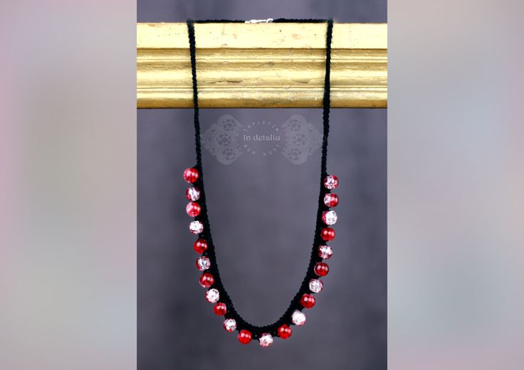 Crocheted necklace with  beads round red crackle.