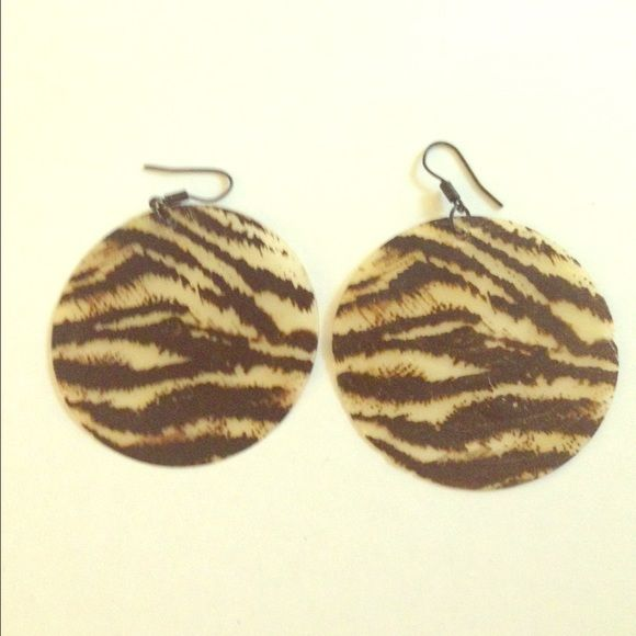 ANIMAL PRINT EARRINGS Thin disc earrings in animal print. Length and circumference is two inches. Worn only a few times. H&M Jewelry Earrings