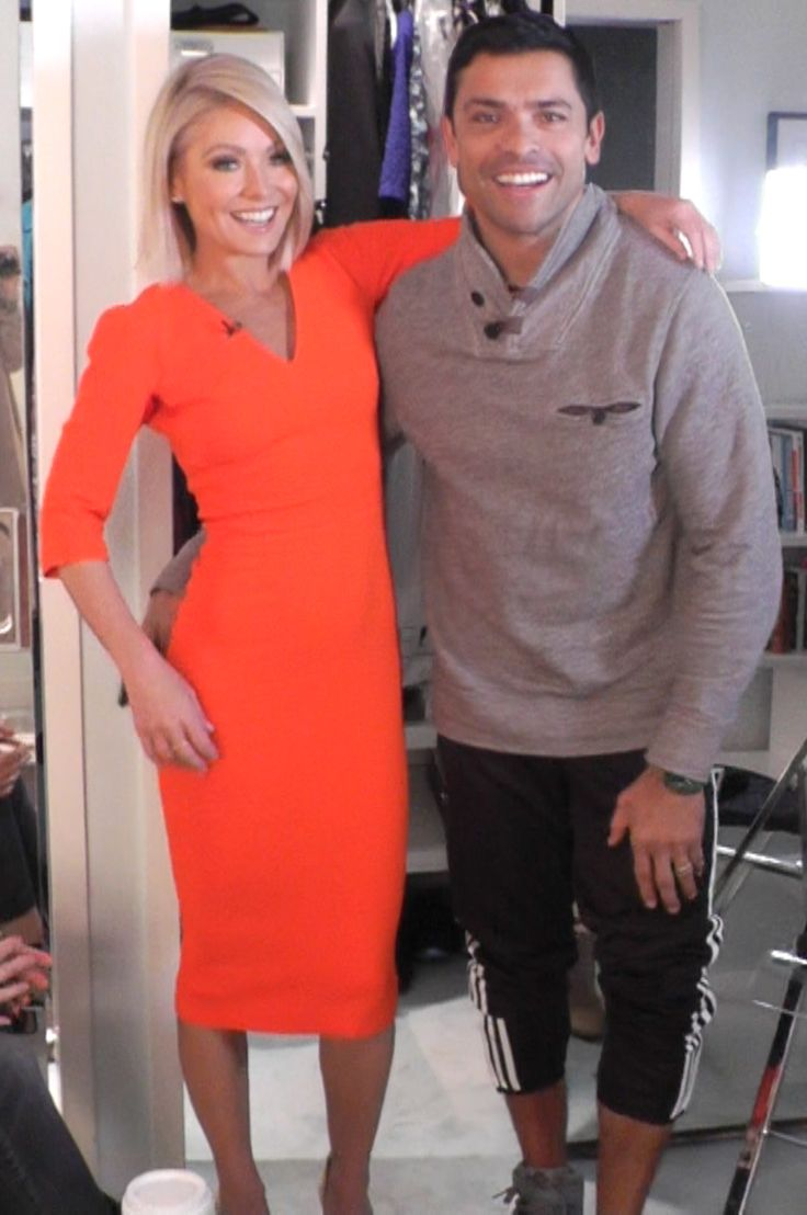 Kelly Ripa (in a neon orange Victoria Beckham dress) with Mark Consuelos. LIVE with Kelly and Michael Fashion Finder.