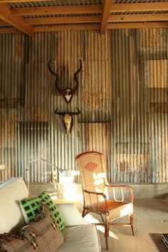 rusty corrugated iron walls ----okay. i would seriously love a room like this. with all my teal and brown accents... and all Ryan and I's deer and elk heads. seriously, REALLY would love it