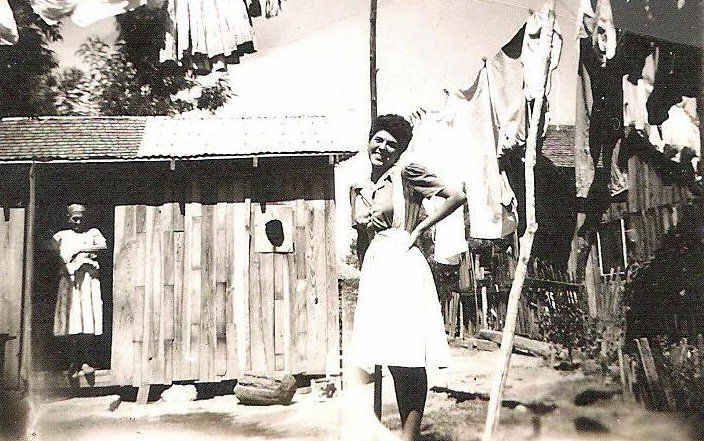 """This is my grandmother, Dominga Villegas (in the foreground) and """"Mama Piedad"""" (in the background). I am not sure how/if they're related. One of the houses behind them is the home that my father was born in, in Weslaco Texas. There was no running..."""