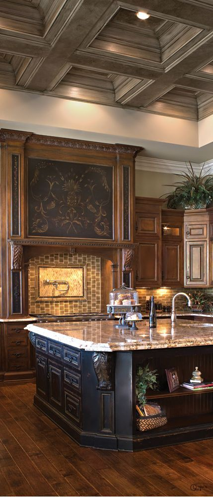 Kitchen ~ Amazing detail on the range hood, the black island and the ceiling...gorgeous!