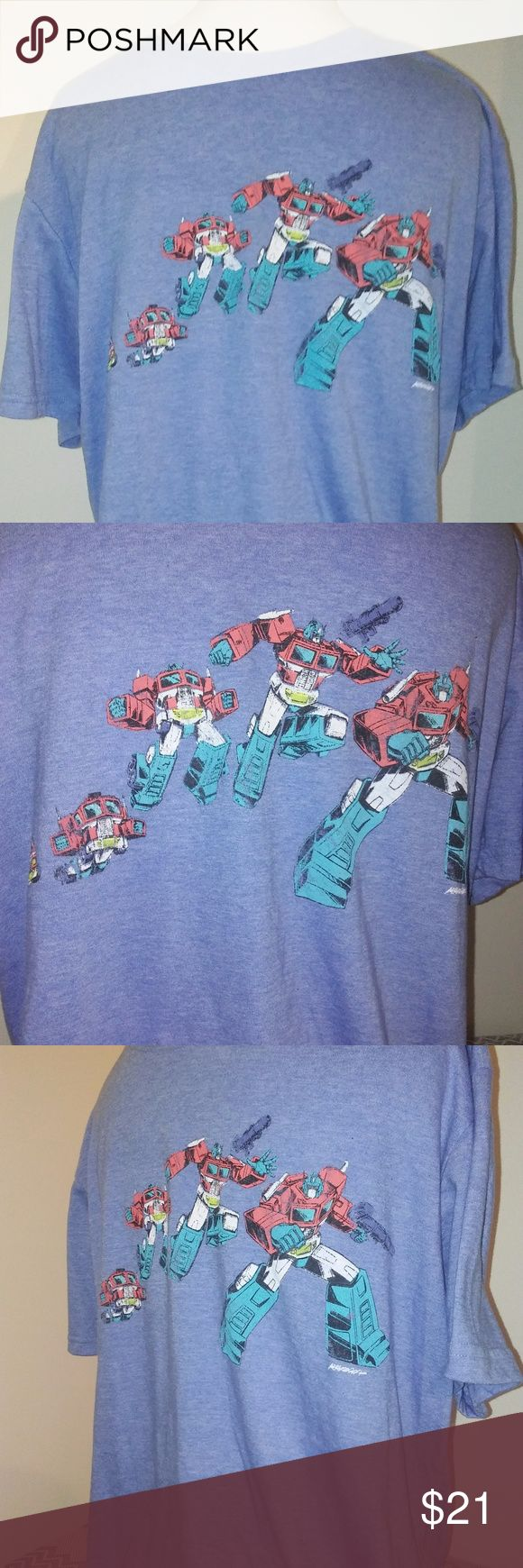 Sweet Transformers Optimus Prime Transformers Lg. NWOT Loot Crate exclusive Transformers Optimus Prime Large vintage style retro short sleeve t-shirt.  Heather light blue shirt shows the one and only Optimus Prime transforming from his 18 wheeler truck into the badass Transformer!  Lightweight   Bundle & Save!! Loot Crate Transformers Exclusive Shirts Tees - Short Sleeve
