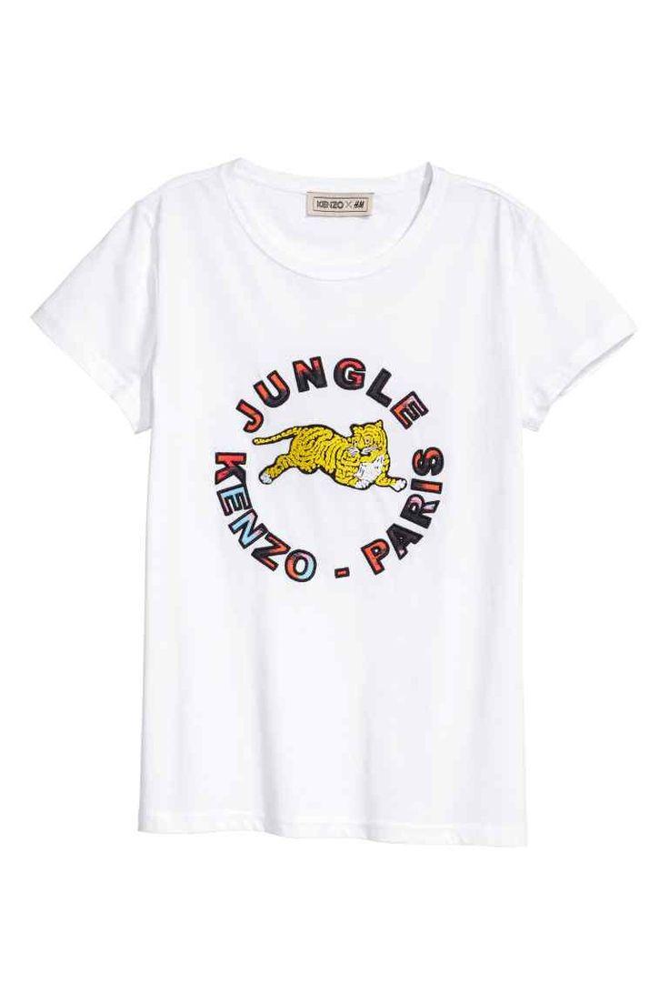 T-shirt com aplicações: KENZO X H&M. T-shirt em jersey de algodão orgânico com aplicações bordadas na frente.