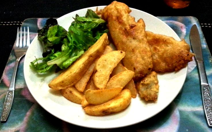 Beer buttered fish with potato wedges and salad