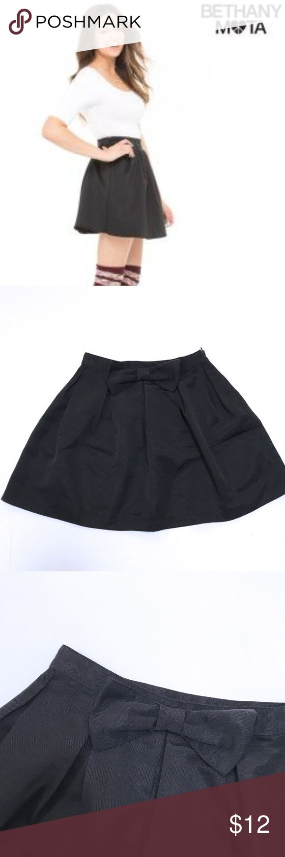 Bethany Mota black bow pleated skirt Bethany Mota skater pleated mini skirt with front bow on waistband. 100% polyester, 17 in. long, roughly 32 1/2 in. waist. Worn once, in excellent condition, like new just to short for me. Aeropostale Skirts Mini