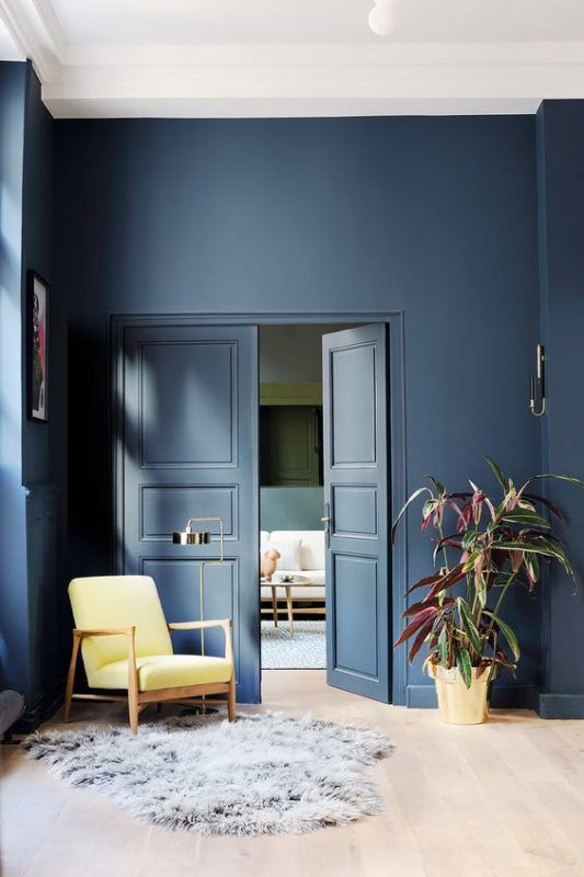 Note molding; doors; and wall painted same color give feeling of room height.  The eye travels up without interruption