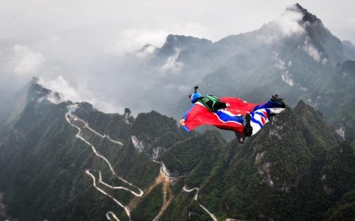 Tom Erik Heimen of Norway glides duringqualification for theWorld Wingsuit League (WWL) China Grand Prix 2016 in Zhangjiajie, central China's Hunan Province