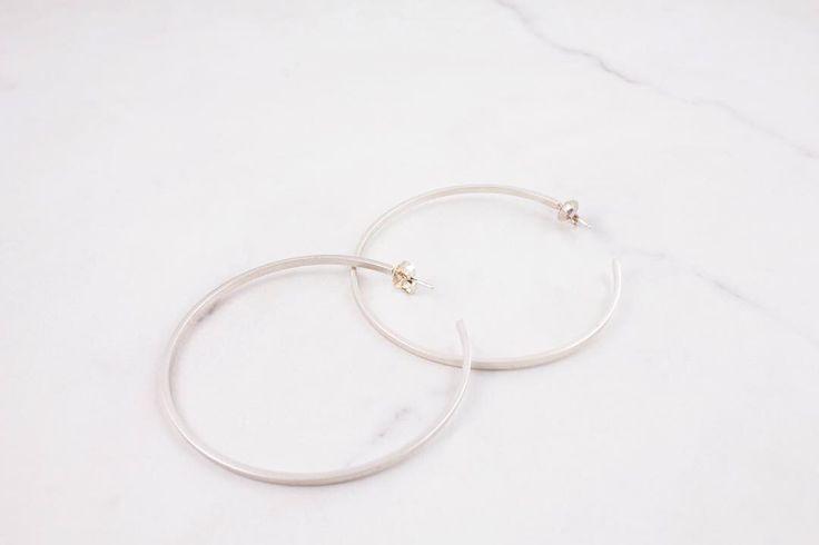 Classic large sterling silver hoop earring.