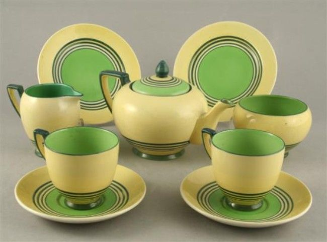 An Art Deco Carlton ware Banded Circles pattern nine piece tea for two set