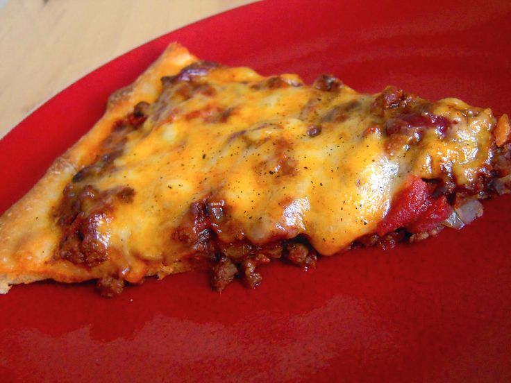 Chili Pizza...yummy and great if you only have a cup of chili left over.  Mom used to do this all the time.