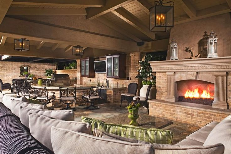 HGTV presents a luxurious pool area including a Mediterranean cabana with an outdoor fireplace that's perfect for entertaining.