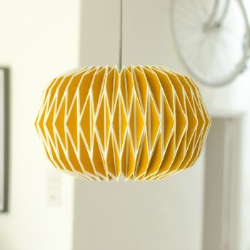 Origamitastic? We think so. This hot best seller is one of our staff favourites and give your interior an instant makeover. Visually quite stunning, this lampshade is a must-have for any 60's Retro, Contemporary and Chic Style interiors which could use an eye-catching feature piece! This cheerful origami style pendant comes in a retro hue - English mustard yellow - however with its bold sculptural design it also looks quite space-agey. Lit the Alena exudes a soft warm mood light, whilst ...