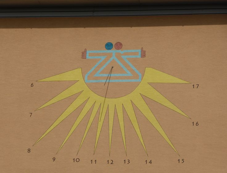 Sun-dial, painted on the school building.