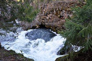 Rogue River, Oregon - Exiting a lava tube below Natural Bridge