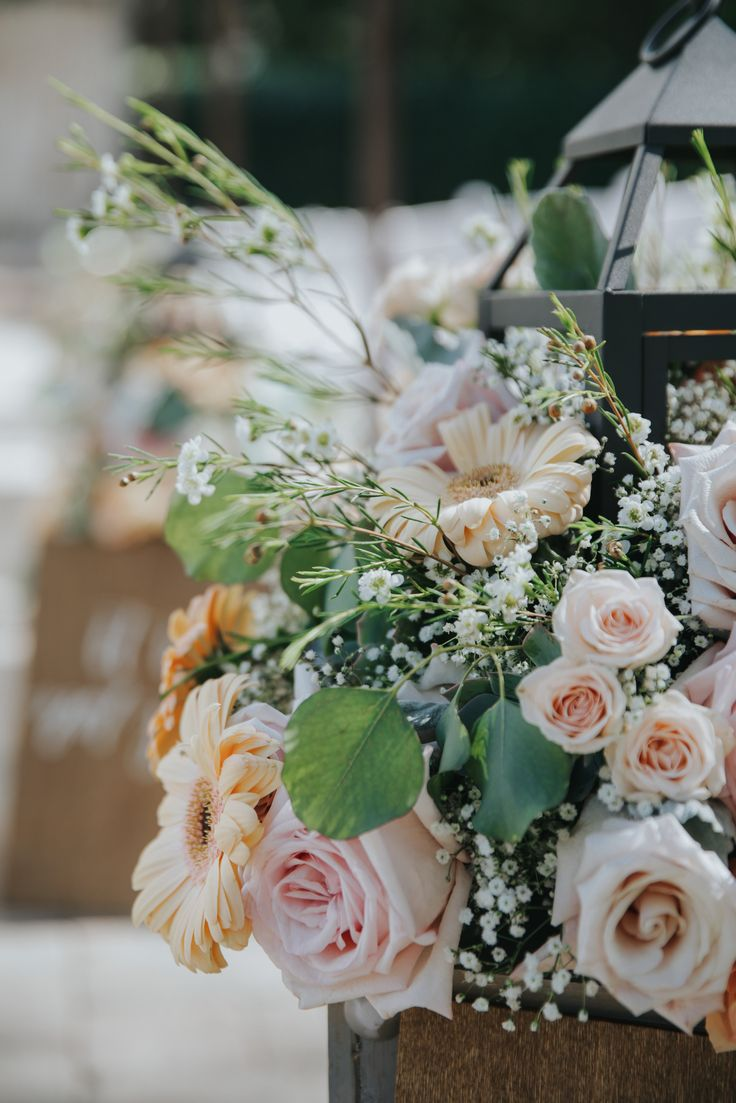 Wedding Ceremony Aisle Floral Arrangements. Gerbera Daises, Blush Roses, Babies Breath, and Wax Flower. Jenny Smith & Co.