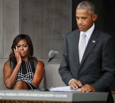 First Lady Michelle Obama wipes away tears as she listens to her husband President Barack Obama speak at the dedication ceremony for the National Museum of African American History and Culture, 9/24/16. S&G