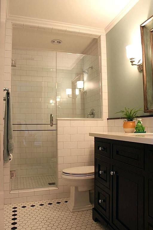 Low wall and glass,  shower curtain instead of door