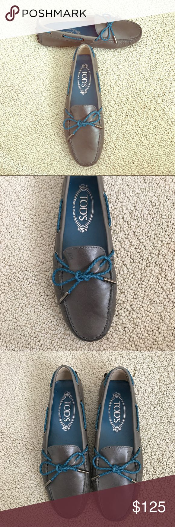 TOD'S- Gommino Grey Leather Driving Loafer So stylish and perfect dressed up or down! Tod's Gommino Leather Driving Loafers in grey with blue lacing. Italian size 36. DETAILS Made in Italy Leather upper Stamped Tod's monogram Exposed hand stitching Rubber pebble outsole Rubber pebble detailing on the heel Excellent preworn condition. No trades please! Tod's Shoes Flats & Loafers