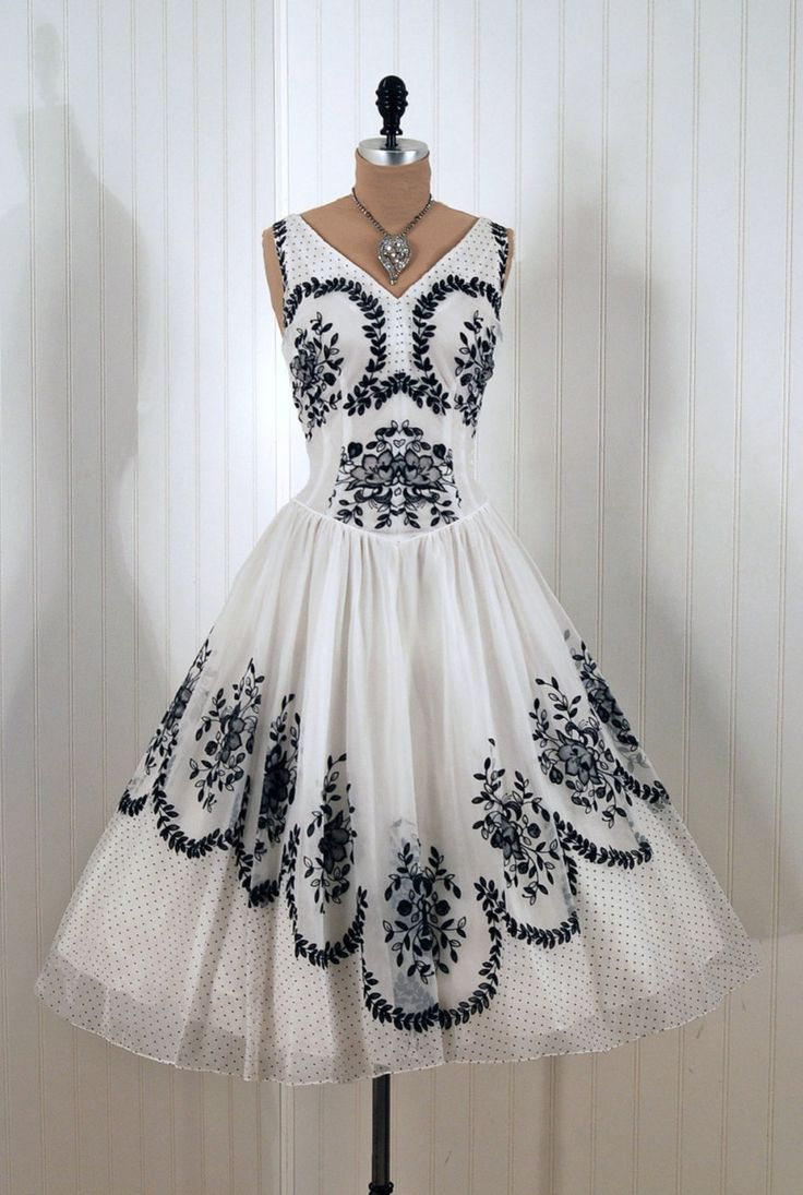 Gorgeous black embroidery on white.  I almost bought a gown in a similar style for a violin performance, but opted for something with more color.