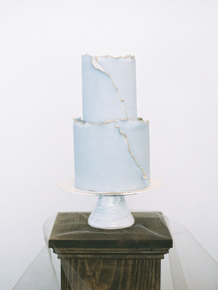 torn edge cake with gold accents