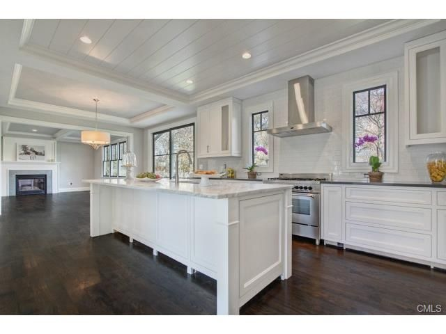 Kitchen With 9 Foot Long Carrera Marble Island Gas Range
