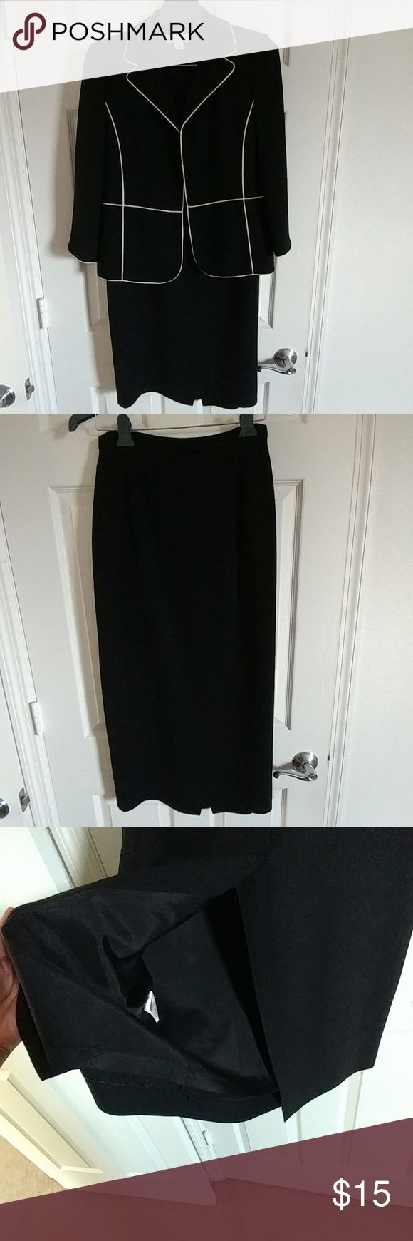 Black & Casual Corner suit Black suit jacket with white corded trim, 3/4 sleeve. Black skirt with split in back. Both are fully lined and. Very comfortable fit. Casual Corner Skirts Skirt Sets