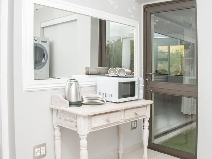 Hartenbos Landgoed 96 - King suite with private entrance and bath. The unit is self-catering (breakfast available on request). It offers wireless internet and premium DSTV with showmax. There is a  private braai area and swimming ... #weekendgetaways #hartenbos #gardenroute #southafrica