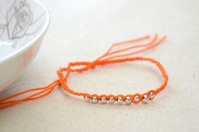 How To Make String Bracelets Step By Step  •  Free tutorial with pictures on how to braid a braided bead bracelet in under 120 minutes