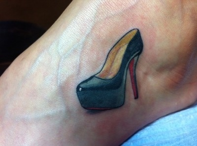 I got a Christian Louboutin high heel done on the side of my left foot about 2 years ago. I decided on this tattoo because I began collecting Vogue Magazines when I was 10 years old and am currently a fashion journalism student. The tattoo was done by LA at Tower Tattoo in Fresno, California.