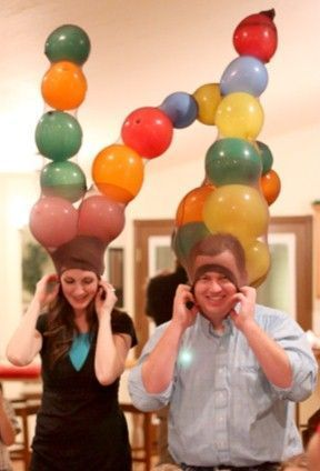 Have guests split into teams of three and give them 15-20 balloons and a pair of pantyhose with the openings at the feet. One person wears the pantyhose on their head; the fastest team to blow up all balloons and stuff them into the pantyhose wins.  Get the tutorial at Party Games Plus.  - http://WomansDay.com