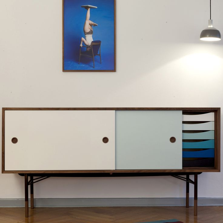 The Sideboard with coloured sliding doors and trays was designed by Finn Juhl for BOVIRKE in 1955