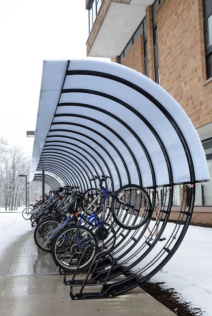 High capacity rack protects bike from the elements. Click image for source & visit the slowottawa.ca boards >> http://www.pinterest.com/slowottawa/boards/