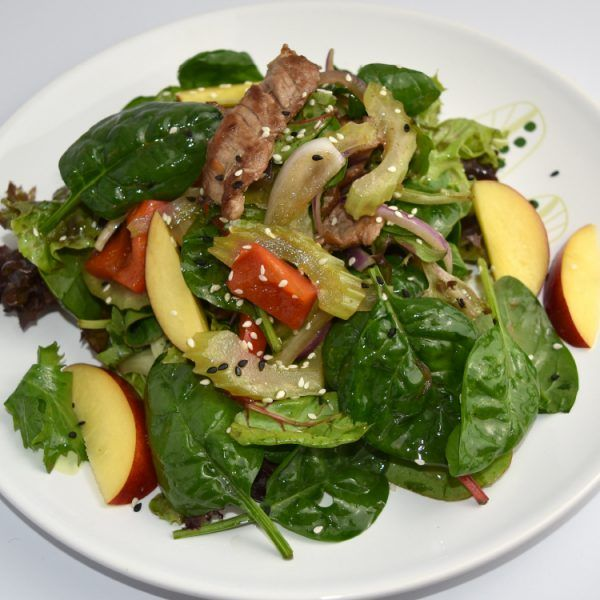 Lamb Salad  This succulent lamb salad is prepared with the freshest seasonal stone fruit and vegetables that will enlighten your tastebuds and brighten your day. A salad tossed with a mountain of plump cinnamon peach, fresh greens, carrot and beetroot, sprinkled with the natural goodness of Nigella, quinoa, steel oats, chia seeds and dressed with wild gooseberry dressing. A clean, hearty and protein rich salad filled with ample healthy gains that are all natural goodness on a plate.