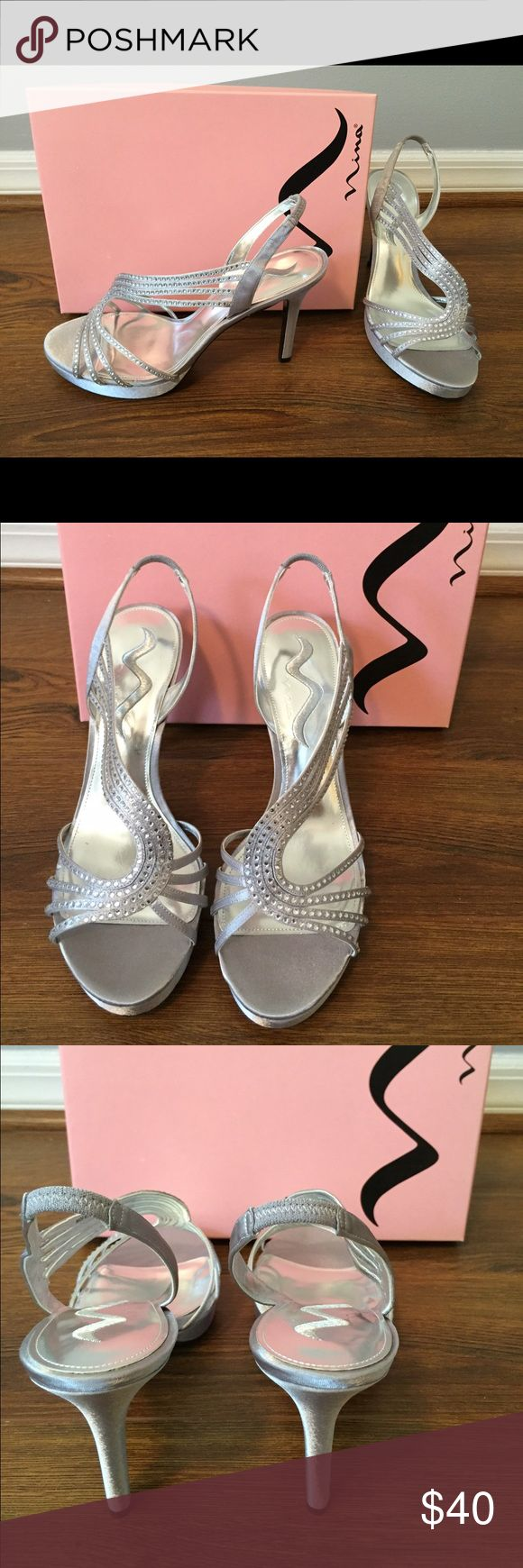Dressy Silver Heels NEVER WORN, perfect condition!!  Stunning silver dress shoes with the just right amount of sparkle.  Perfect for a wedding or other formal event. Nina Shoes Heels