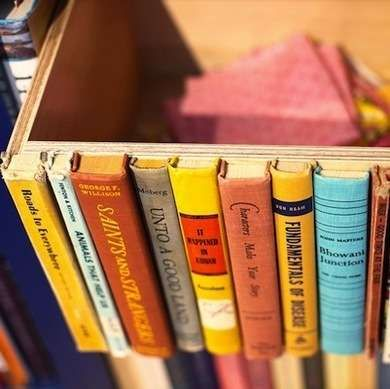 Book Box Storage - Collect old and broken textbooks and novels, remove the spines, then hot-glue them to one side of the box.