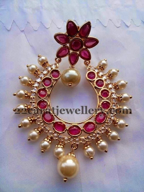 Real ruby and polki adorned chand bali patterned designer earrings with 1 gram gold metal, Small pearls embellished and hanging all over....