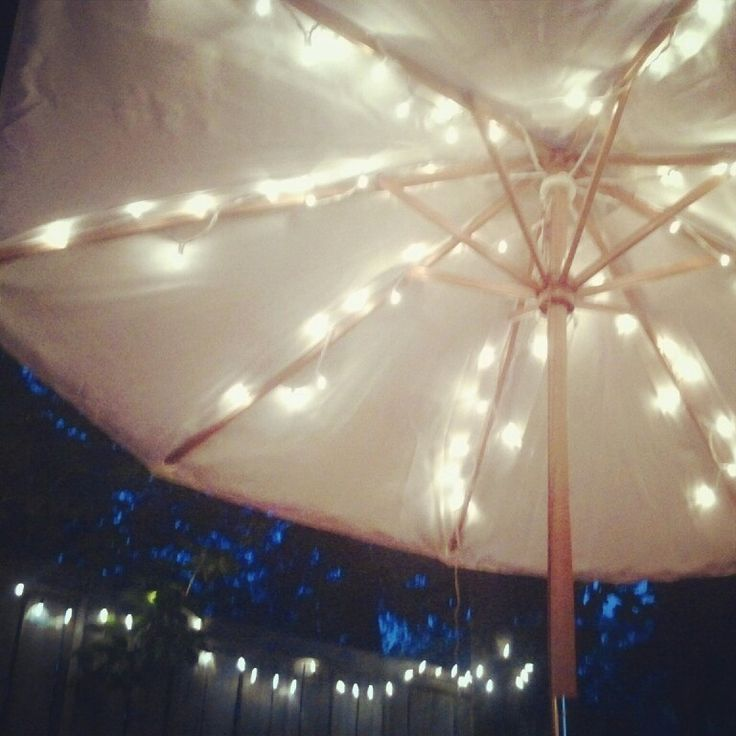 String Lights On Umbrella : 78 Best ideas about Patio Umbrella Lights on Pinterest Backyard string lights, Patio lighting ...