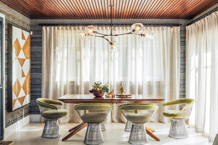 so much to love...from the wooden paneled ceiling to the textured wallpaper + the mod seating..