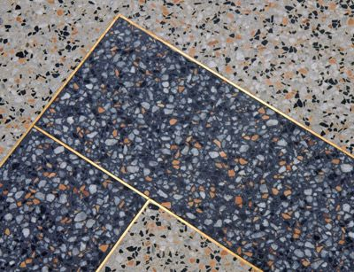 blue terrazzo flooring with brass inlay  Great color and aggregates chosen for this terrazzo floor.  Look at the fine details.  www.doyledickersonterrazzo.com