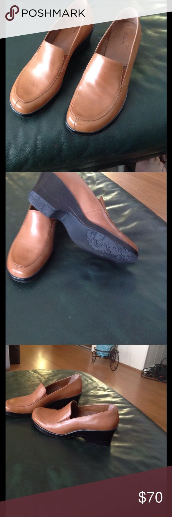 Clarks dark tan leather shoes Dark tan clarks leather wedge closed toed shoe size 9M. Worn one time in excellent condition. Clarks Shoes Wedges